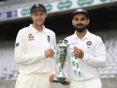 Joe Root and Virat Kohli with the Pataudi Trophy. AP