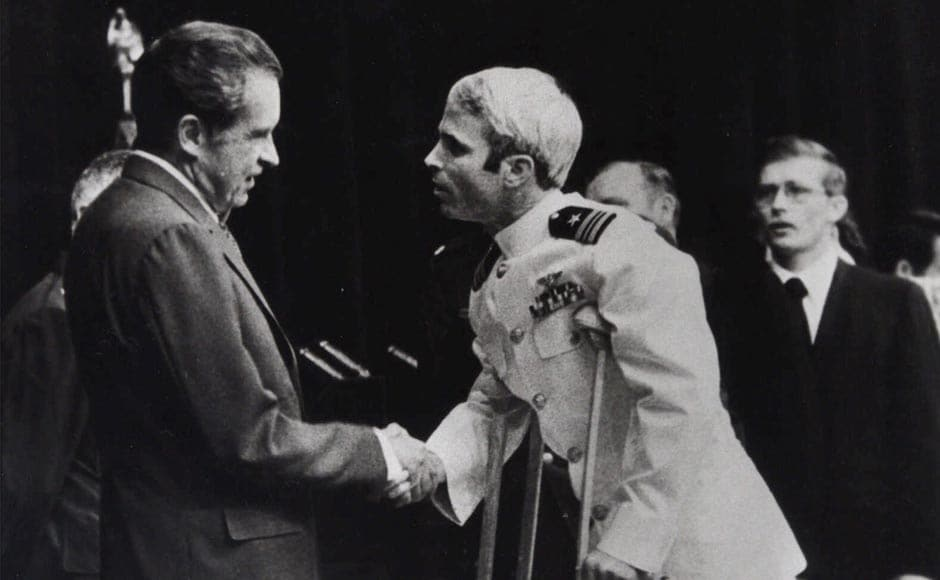 In this 25 May, 1973 file photo, McCain is seen being greeted by then US president Richard Nixon, after his release from the POW camp in North Vietnam. McCain returned home from his years as a POW on crutches and never regained full mobility in his arms and leg. AP