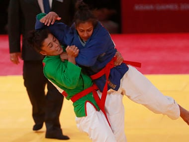 Uzbekistan's Gulnor Sulaymanova ,in green, competes against India's Pingky Balhara during their women's -52kg final kurash match at the 18th Asian Games in Jakarta. AP