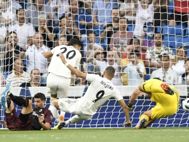 Real Madrid's French forward Karim Benzema (C) scores. AFP