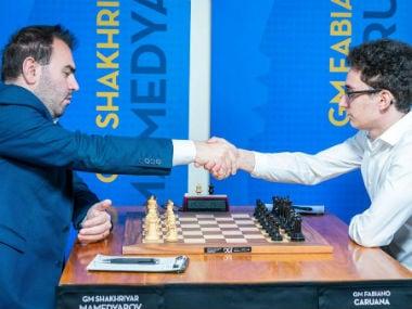 Shakhriyar Mamedyarov and Fabiano Caruana shake hands ahead of their drawn third round encounter. Image credit: Twitter/@GrandChessTour