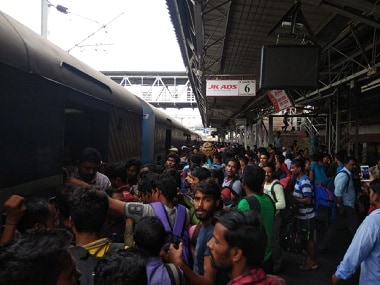 Migrant workers boarding a train to head to their home state after the floods in Kerala. Image Courtesy: TK Devasia