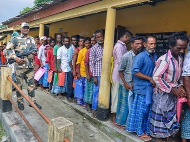 People in Assam queued to check their names in the NRC in July. PTI