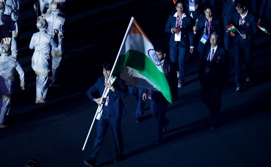 Javelin thrower Neeraj Chopra led the Indian contingent in the parade of athletes. AP