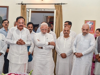 Prime Minister Narendra Modi, Vice President Venkaiah Naidu and BJP President Amit Shah stand with others as they tribute to former prime minister Atal Bihari Vajpayee, at his Krishna Menon Marg residence, in New Delhi. PTI