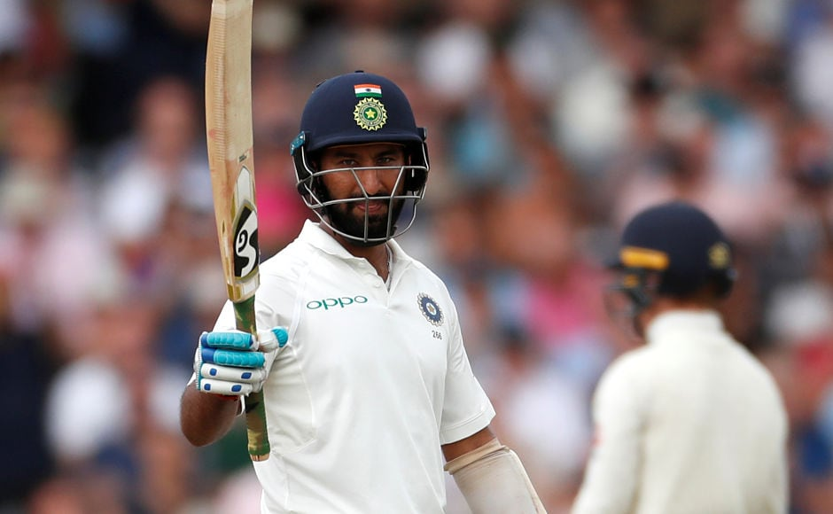 After the horror end to his first innings on the first day, India's Cheteshwar Pujara scored a fifty and was dismissed for 72. Reuters