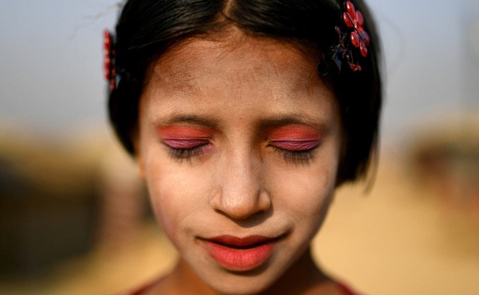 Rohingya Muslim women and girls in the refugee camps of southern Bangladesh decorate their cheeks with swirls of yellow paste made from ground tree bark. Thanaka is a type of sun protection that dates back centuries. Women in the camps say that the cooling paste leaves them with a feeling of normalcy. Reuters/Clodagh Kilcoyne
