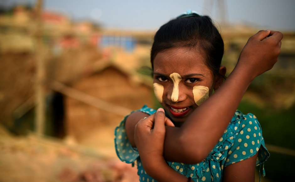 Rumana (10) also applies paste to her face. Some women in the camp also apply thanaka to ward off insects. Reuters/Clodagh Kilcoyne