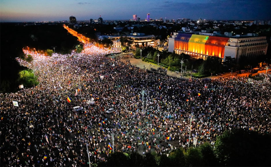 Tens of thousands of Romanians flocked to the anti-government protest organised by expatriates on Friday, urging the left-wing ruling Social Democrat (PSD) government to resign and call an early election. People shine lights on their mobile phones during protests outside the Romanian government headquarters in Bucharest. AP