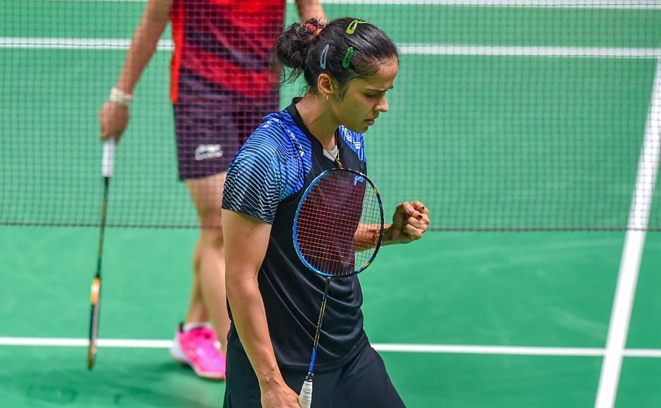 Indian shuttler Saina Nehwal reacts after winning a point against Indonesia's F Fitriani during women's singles round badminton match. She advanced to quarter-final along with PV Sindhu. PTI