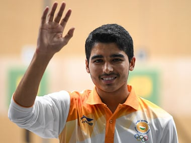 India's Saurabh Chaudhary celebrates after winning the men's 10m air pistol shooting final during the 2018 Asian Games in Palembang on August 21, 2018. / AFP PHOTO / Mohd RASFAN