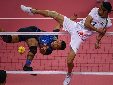 India's Thokchom Seitaram Singh jumps for the ball against Iran's Jafari Mehrdad during the sepak takraw men's team regu match during the 2018 Asian Games. AFP