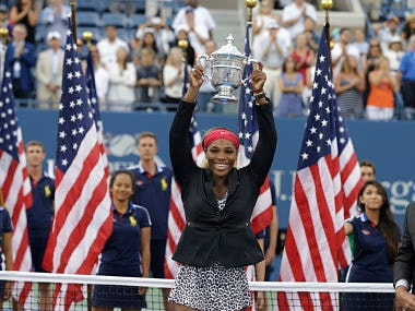 FILE - In this Sept. 7, 2014, file photo, Serena Williams holds the championship trophy after defeating Caroline Wozniacki in the championship match of the 2014 U.S. Open tennis tournament, in New York. Serena Williams was seeded No. 17 for the U.S. Open, higher than her current ranking of No. 26. The U.S. Tennis Association announced the seedings for the main draws of women's and men's singles on Tuesday, Aug. 21, 2018. (AP Photo/Darron Cummings, File)