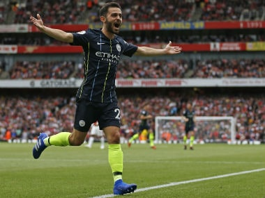 Manchester City's Bernardo Silva celebrates after scoring their second goal against Arsenal. AFP