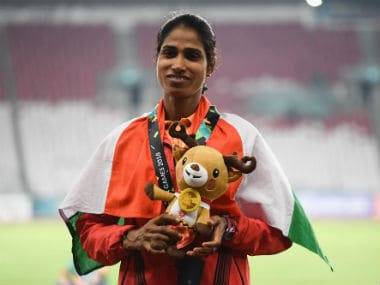 Sudha Singh poses with her medal after finishing second in women's 3000m steeplechase. AFP