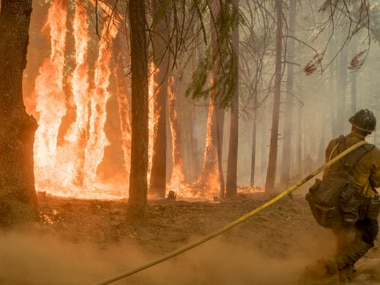 Fire crew try to contain wildfire in California. Reuters