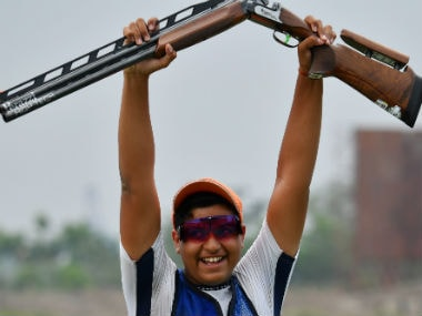 India's Shardul Vihan lifts his gun after winning silver in the men's shooting double trap final at the 2018 Asian Games. AFP