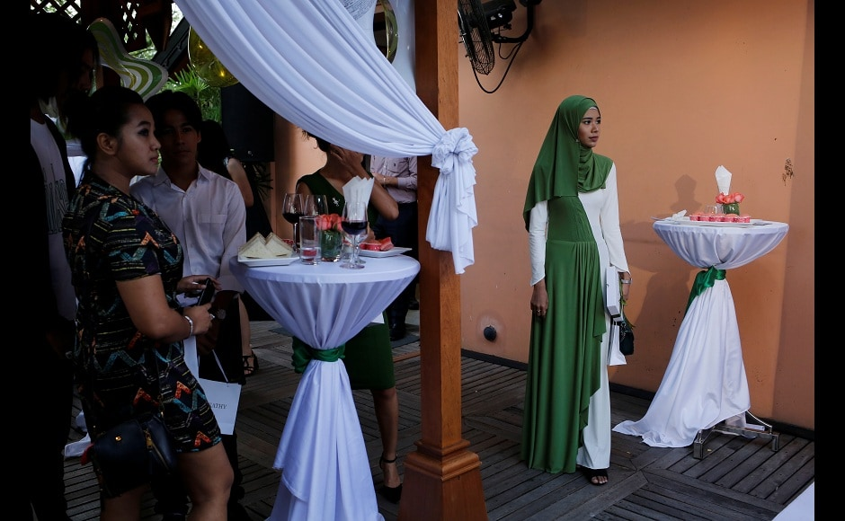 Win Lae Phyu Sin recently attended a beauty product launch along with other beauty bloggers in Yangon, Myanmar. She sported a white and green full-sleeved gown and a green headscarf. Reuters/Ann Wang