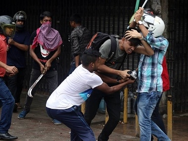 A journalist being beaten by goons during the student protests in Dhaka. Image procured by Greeshma Rai