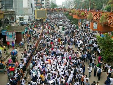 Bangladeshi students block a road during a protest in Dhaka, Bangladesh on Saturday. AP