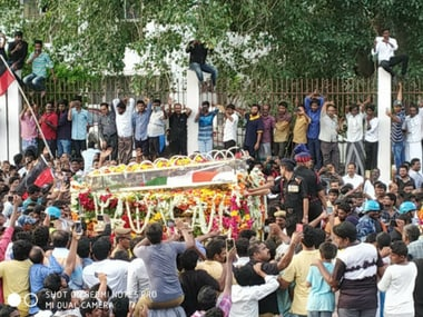 Karunanidhi laid to rest at Chennais Marina Beach next to mentor CN Annadurai as lakhs bid farewell