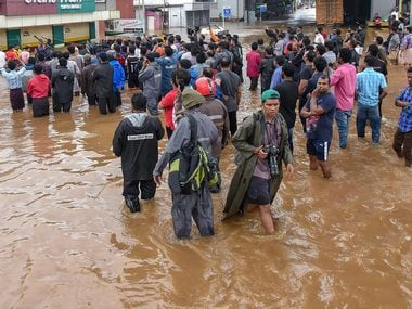 People being rescued from a flood-affected area in Kerala. PTI