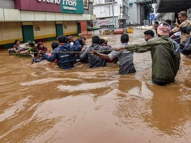 People being rescued from Kochi following heavy rainfall. PTI