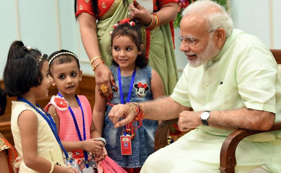 On the occasion of Raksha Bandhan on Saturday, children tied rakhi to Prime Minister Narendra Modi in New Delhi. Twitter @BJP4India