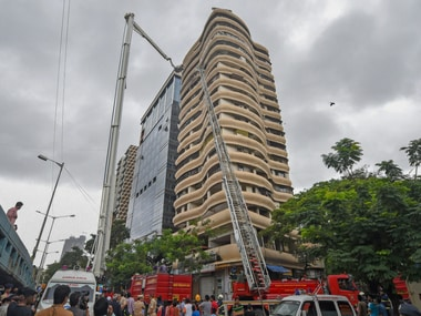Fire fighters carry out rescue work after a fire broke out at the Crystal Tower in Mumbai on Wednesday. PTI
