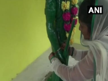 Shanti Udke, sister of late police constable ties rakhi to his statue. ANI