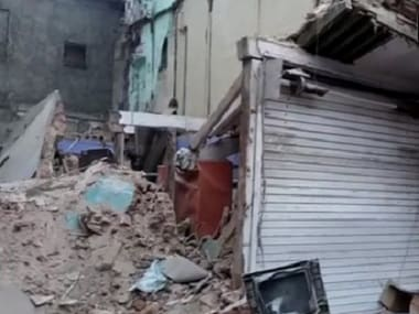 The debris of the collapsed building. Twitter @ANI