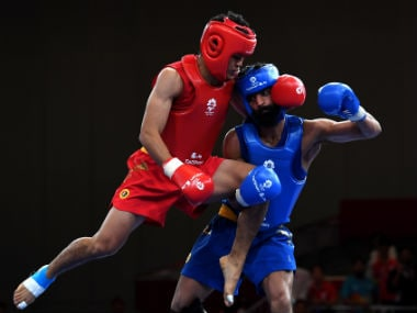 File image of India's Surya Bhanu Partap Singh (R) at the Asian Games. AFP