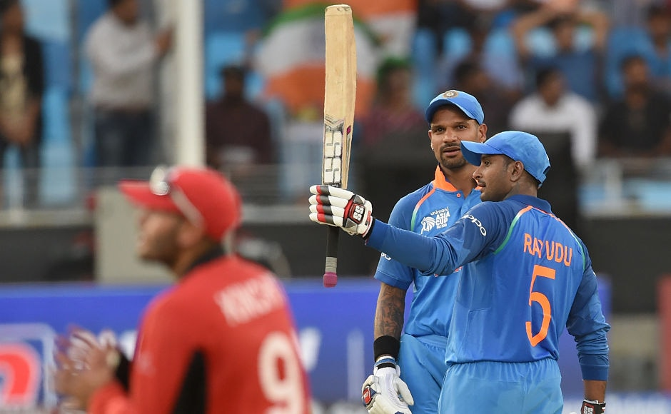 Along with Dhawan,Ambati Rayudu (R) brought up hishalf-century in India's first match of the tournament. AFP