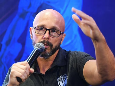 Northeast United FC Head Coach Eelco Schattorie of the Indian Super League (ISL) gestures as he speaks during an event in Kolkata on September 22, 2018. This will be the fifth season of the Indian Super League, since its establishment in 2014. / AFP PHOTO / Dibyangshu SARKAR