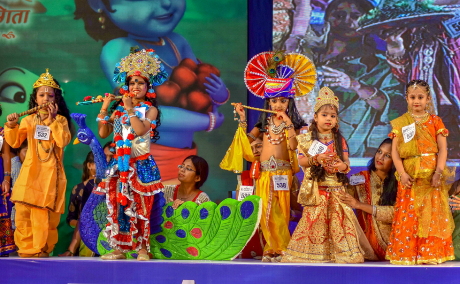 In Tamil Nadu, the youngest male child of the family dresses up as Lord Krishna and rocks the oonjal, or swing. Young boys dress up as Lord Krishna take part in a competition in Chennai. PTI