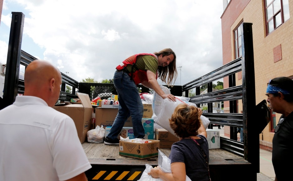To help the residents with the post-explosions chaos, Red Cross members brought in a truck of donations to waiting volunteers outside the Parthum School in Lawrence, Massachusetts. AP