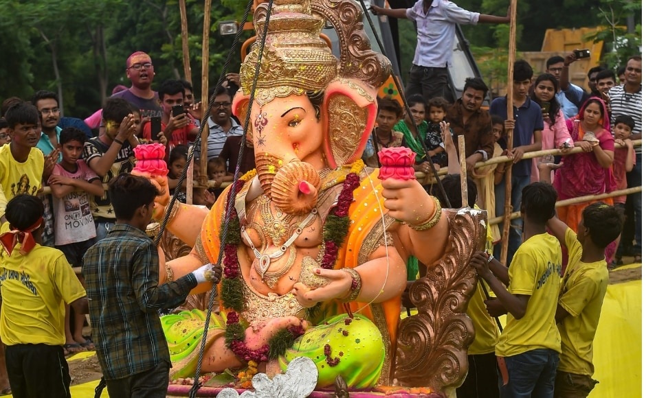 Volunteers and devotees immerse Hyderabad's most famous Khairatabad Ganesh idol, the tallest in the city at 57 feet, in the Hussain Sagar Lake. PTI