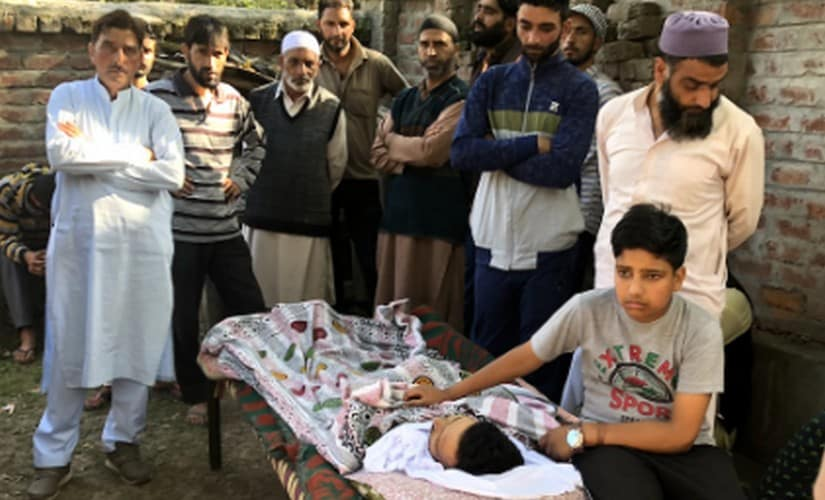 Yudvir Singh sits besides his father Kulwant Singh's body. Sameer Yasir