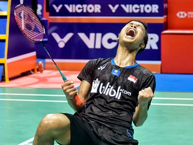 Anthony Sinisuk Ginting of Indonesia reacts after beating Kento Momota of Japan in the men's singles final at the BWF China Open badminton tournament in Changzhou in eastern China's Jiangsu province, Sunday, Sept. 23, 2018. Sinisuk Genting beat Momota, 2-0. (Chinatopix via AP)