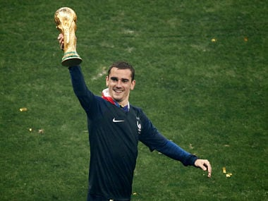 Soccer Football - World Cup - Final - France v Croatia - Luzhniki Stadium, Moscow, Russia - July 15, 2018 France's Antoine Griezmann holds the trophy as he celebrates winning the World Cup REUTERS/Christian Hartmann - RC14B6D20170