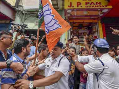 Police personal try to stop BJP activists protesting during 'Bangla Bandh' strike against the state government, in Kolkata, Wednesday, 26 September, 2018. PTI