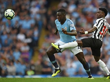 Newcastle United's Ghanaian midfielder Christian Atsu (R) vies with Manchester City's French defender Benjamin Mendy during the English Premier League football match between Manchester City and Newcastle United at the Etihad Stadium in Manchester, north west England, on September 1, 2018. / AFP PHOTO / Oli SCARFF / RESTRICTED TO EDITORIAL USE. No use with unauthorized audio, video, data, fixture lists, club/league logos or 'live' services. Online in-match use limited to 120 images. An additional 40 images may be used in extra time. No video emulation. Social media in-match use limited to 120 images. An additional 40 images may be used in extra time. No use in betting publications, games or single club/league/player publications. /