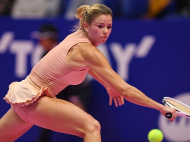 Modestly ranked Italian Camila Giorgi pulled off an upset to beat three-time winner Caroline Wozniacki in the Pan Pacific Open. AFP