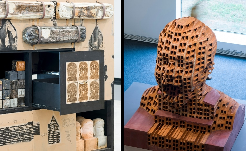 Partha Dasgupta's Recollection of a Manuscript (left), ceramic wooden boards pasted with lithographs and iron fittings are also on display at the Jawahar Kala Kendra along with the terracotta hollow block and cement work by LN Tallur titled Man Exhibiting Holes (right). Indian artists were selected for the exhibition through a nationwide open call and have on display several worksthat highlight social issues.