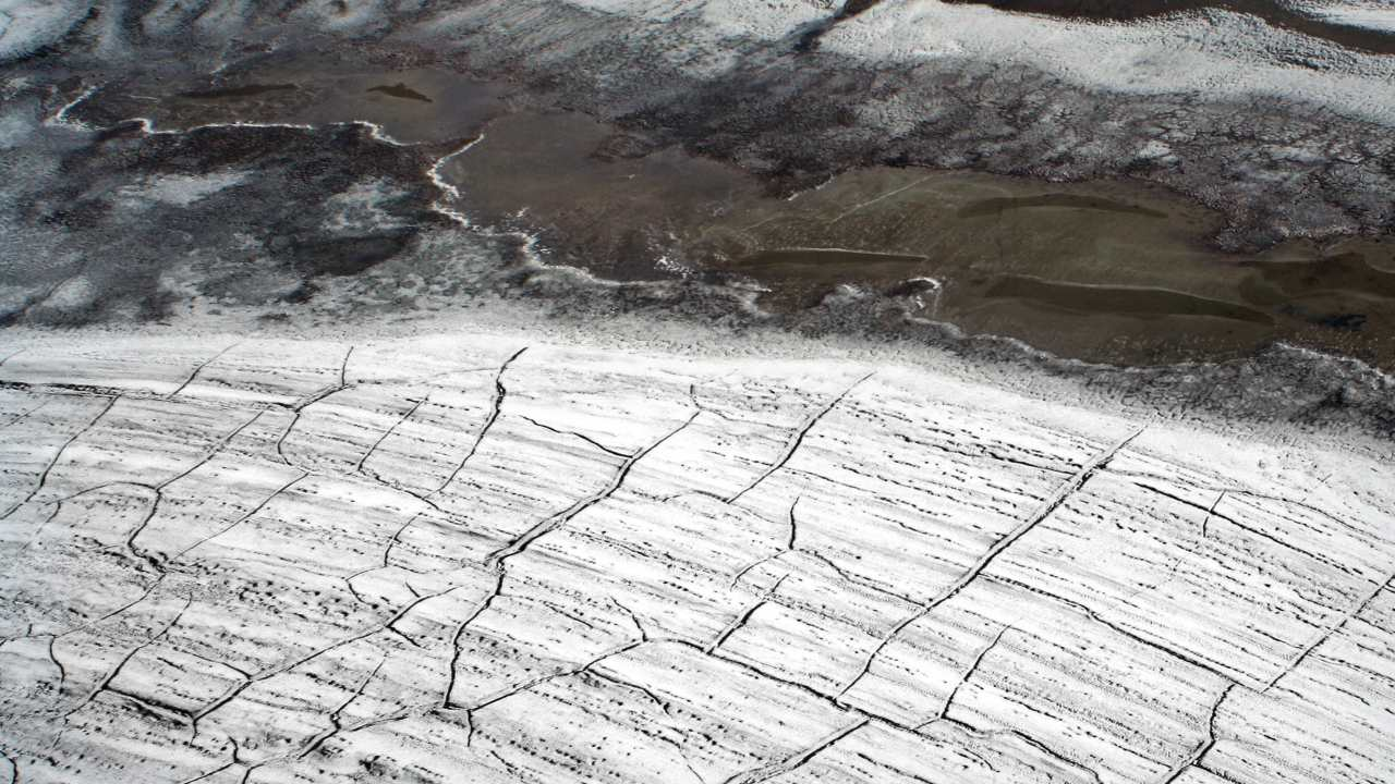 Cracks and faults in the high Artic permafrost as seen from a helicopter suspected to be due to thawing. Image courtesy: Wikimedia Commons