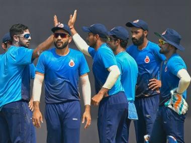 Delhi's team celebrate a wicket against Saurashtra. PTI
