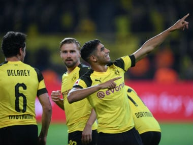 Dortmund's Moroccan defender Achraf Hakimi celebrates scoring his team's third goal. AFP