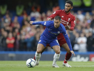 Chelsea's Eden Hazard in action against Liverpool's Joe Gomez in their Premier League clash. AFP