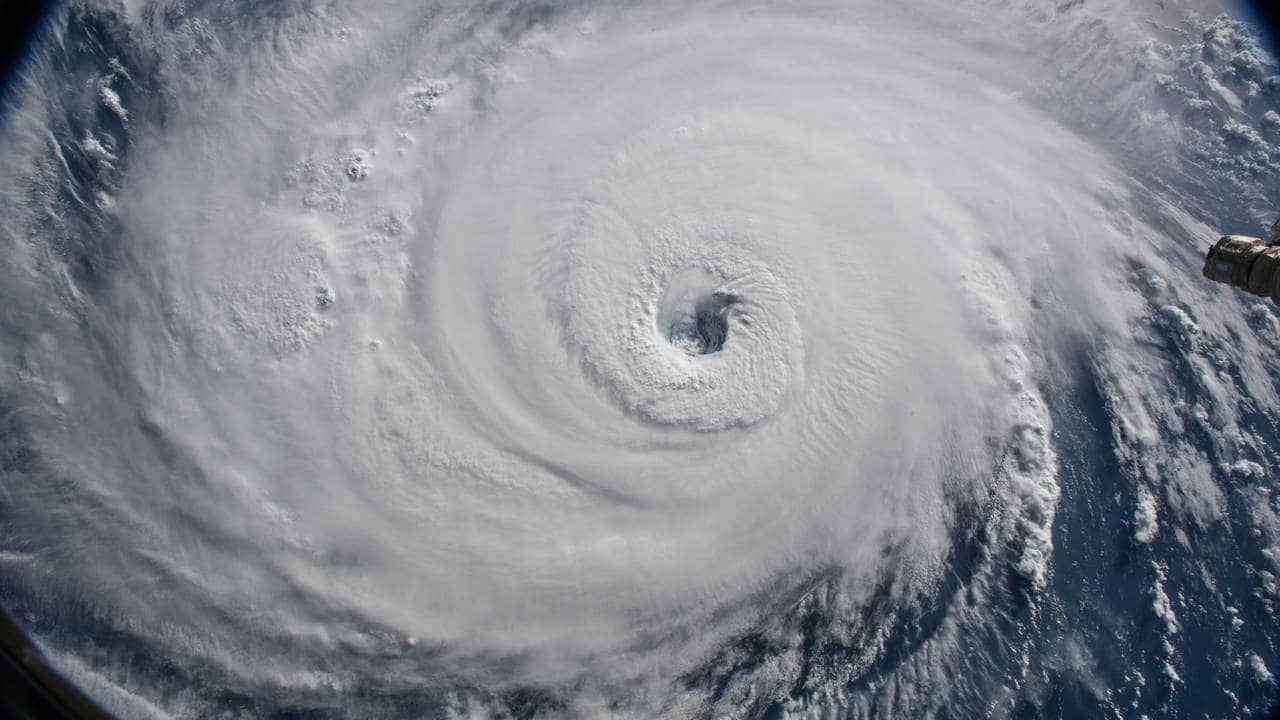 A view of Hurricane Florence is shown churning in the Atlantic Ocean in a west, north-westerly direction heading for the eastern coastline of the United States, taken by cameras outside the International Space Station, September 12, 2018. NASA/Handout via REUTERS ATTENTION EDITORS - THIS IMAGE WAS PROVIDED BY A THIRD PARTY - RC1A860A5660