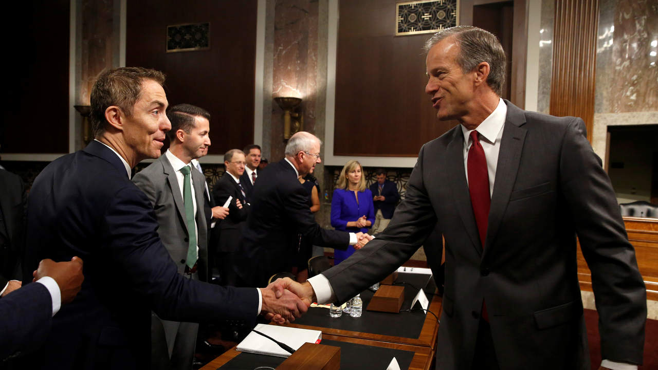 Keith Enright, chief privacy officer at Google LLC, greets Senator John Thune (R-SD) chairman of the Senate Commerce, Science and Transportation Committee before testifying on safeguards for consumer data privacy in Washington, U.S., September 26, 2018. REUTERS/Joshua Roberts - RC17C8DA7A00